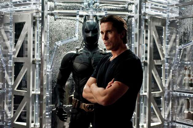 "In this film image released by Warner Bros., Christian Bale portrays Bruce Wayne and Batman in a scene from ""The Dark Knight Rises."" (AP PHoto/Warner Bros.) Photo: Ron Phillips / (c) 2012 Warner Bros. Entertainment Inc. and Legendary Pictures Funding LLC"