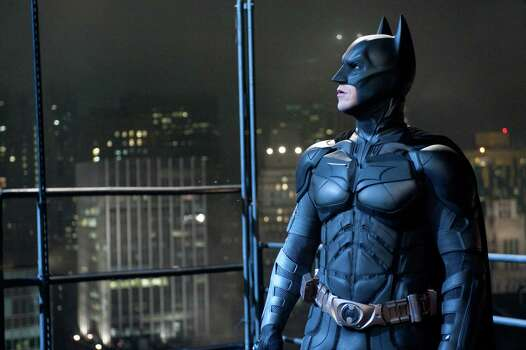 """In this film image released by Warner Bros., Christian Bale portrays Bruce Wayne and Batman in a scene from """"The Dark Knight Rises."""" (AP PHoto/Warner Bros.) Photo: Ron Phillips / (c) 2012 Warner Bros. Entertainment Inc. and Legendary Pictures Funding, LLC"""
