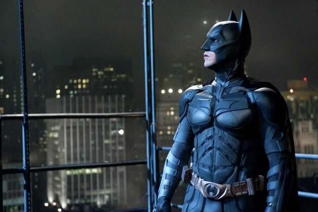 "In this film image released by Warner Bros., Christian Bale portrays Bruce Wayne and Batman in a scene from ""The Dark Knight Rises."" (AP PHoto/Warner Bros.) Photo: Ron Phillips / (c) 2012 Warner Bros. Entertainment Inc. and Legendary Pictures Funding, LLC"