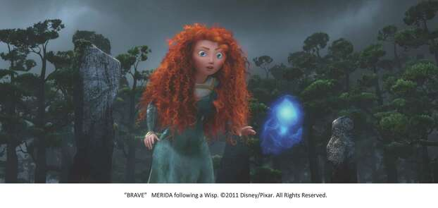"Princess Merida (voiced by Kelly Macdonald) follows a Wisp in ""Brave."" Photo: Pixar"