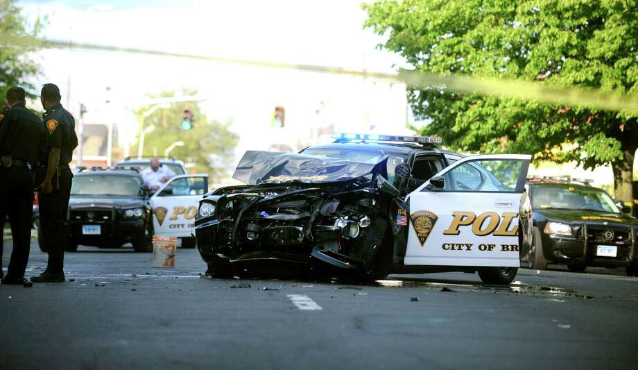 A police car collided with an SUV on State Street in Bridgeport Thursday, May 10, 2012. Photo: Autumn Driscoll / Connecticut Post