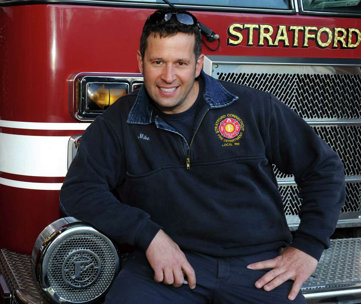 Mike Apatow, of Milford, poses at Stratford Fire Station, Company 2, in Stratford, Conn. May 10th, 2012, where he works as firefighter. Apatow, who had a radioactive stress test Wednesday, was pulled over later in the day, in Newtown, by a state police trooper after a radioactivity detector in the trooper's car was set off when Apatow passed. The detectors are used to help identify potential terror threats. Apatow was not on duty at the time.