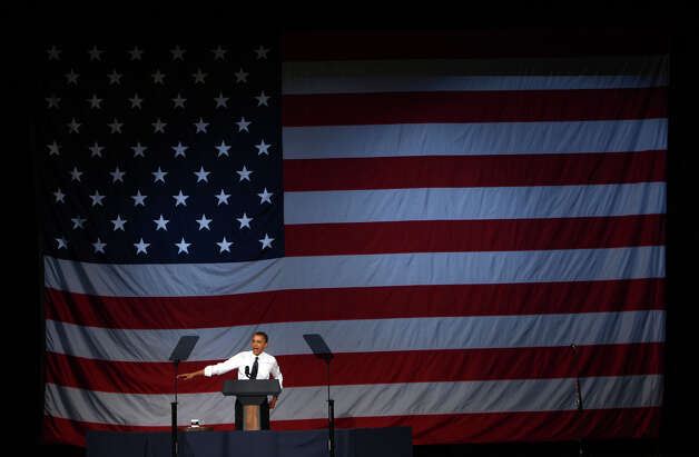 U.S. President Barack Obama speaks during a fund raiser at the Paramount Theater in Seattle on Thursday, May 10, 2012 . The president attended two fund raisers during his Seattle visit. Photo: JOSHUA TRUJILLO / SEATTLEPI.COM