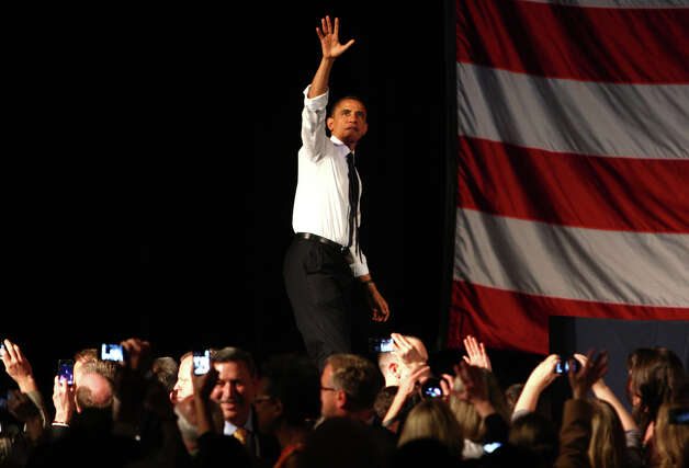 U.S. President Barack Obama waves to supporters during a fund raiser at the Paramount Theater in Seattle on Thursday, May 10, 2012 . The president attended two fund raisers during his Seattle visit. Photo: JOSHUA TRUJILLO / SEATTLEPI.COM