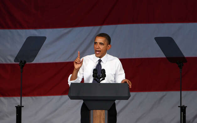 U.S. President Barack Obama speaks during a fund raiser at the Paramount Theater in Seattle on Thursday, May 10, 2012 . The president attended two fund raisers during the visit. Photo: JOSHUA TRUJILLO / SEATTLEPI.COM