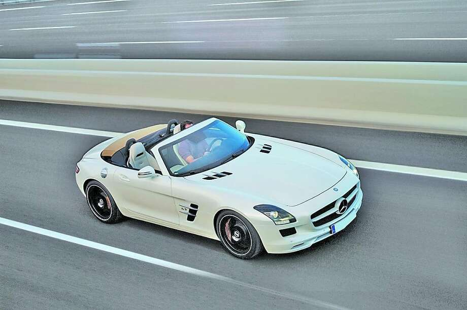 or the 2012 model year, a Roadster joins the Mercedes SLS AMG Coupe, paying homage to the original drop-top 300 SL. Power for this limited production, two-seat sport touring Roadster is also a 6.3-liter DOHC, 32-valve, naturally aspirated AMG V8 engine with an eight-velocity stack intake and electronic fuel injection. Photo: Mercedes-Benz, Wieck