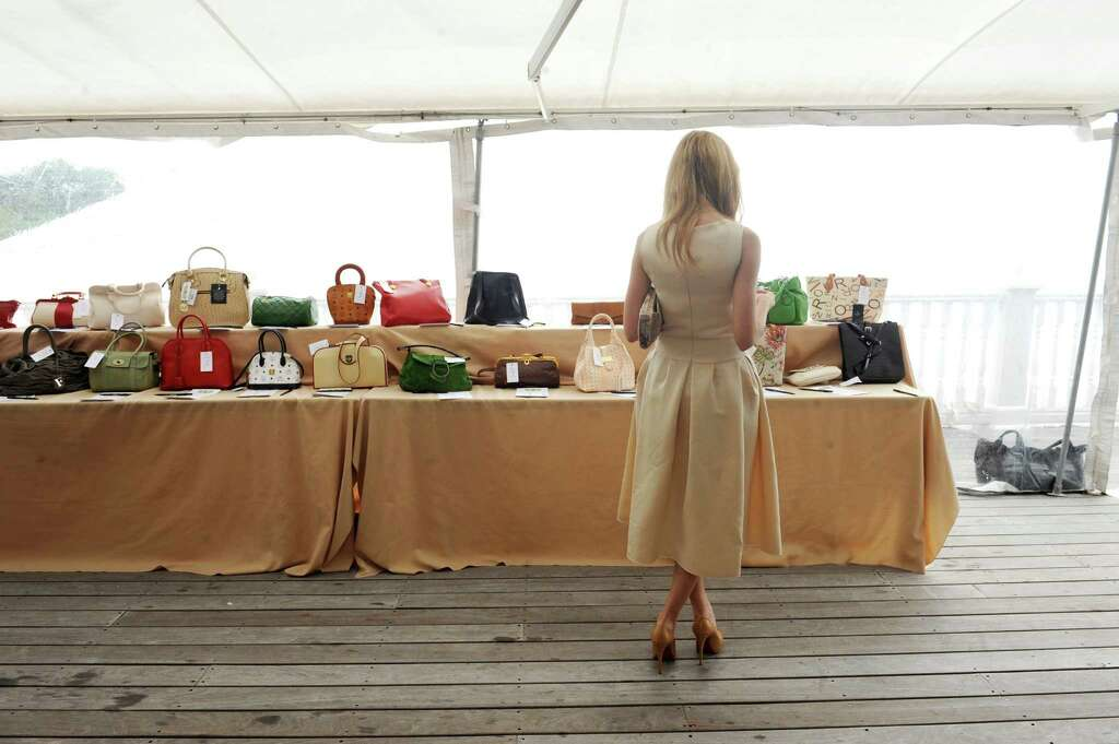 Leyla Karakas Of New York City Looks At The Selection Designer Handbags