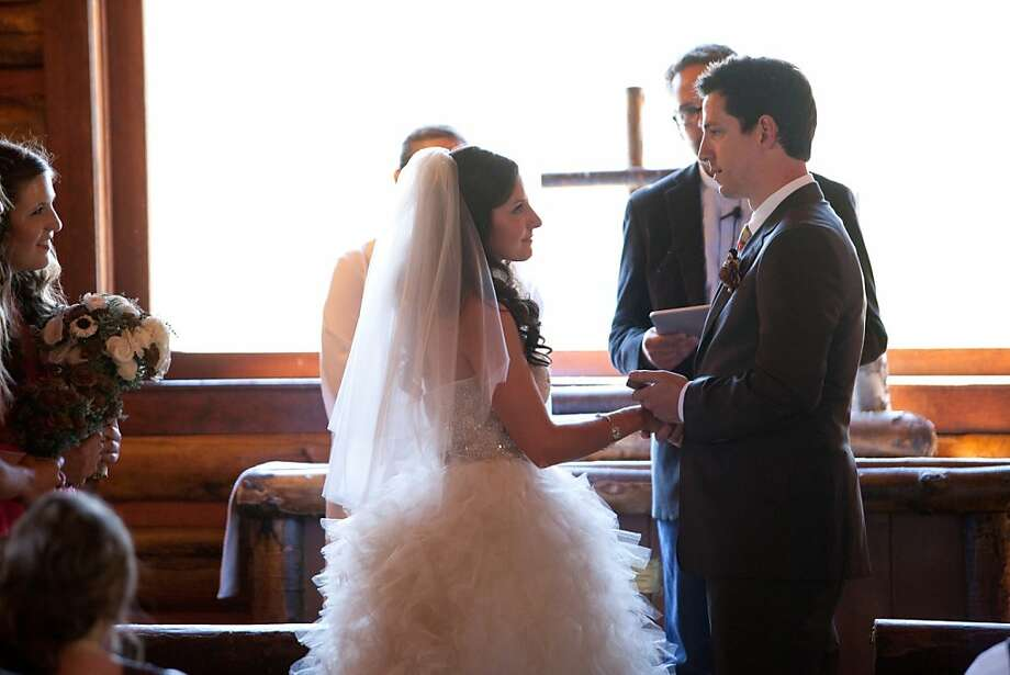 Dave Morin reads his vows to Brit via iPhone. Photo: David Stubbs
