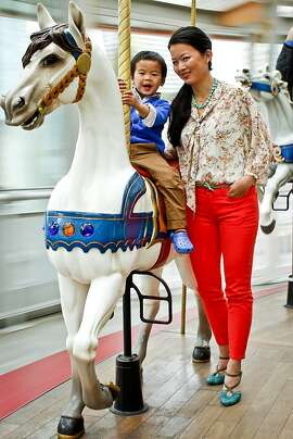 """Cat Seto, author of, """"Mom, Inc.,"""" is seen with her son, Nolan, 3, at the Children's Creativity Carousel at the Yerba Buena Gardens in San Francisco, Calif., on Thursday, May 3, 2012."""