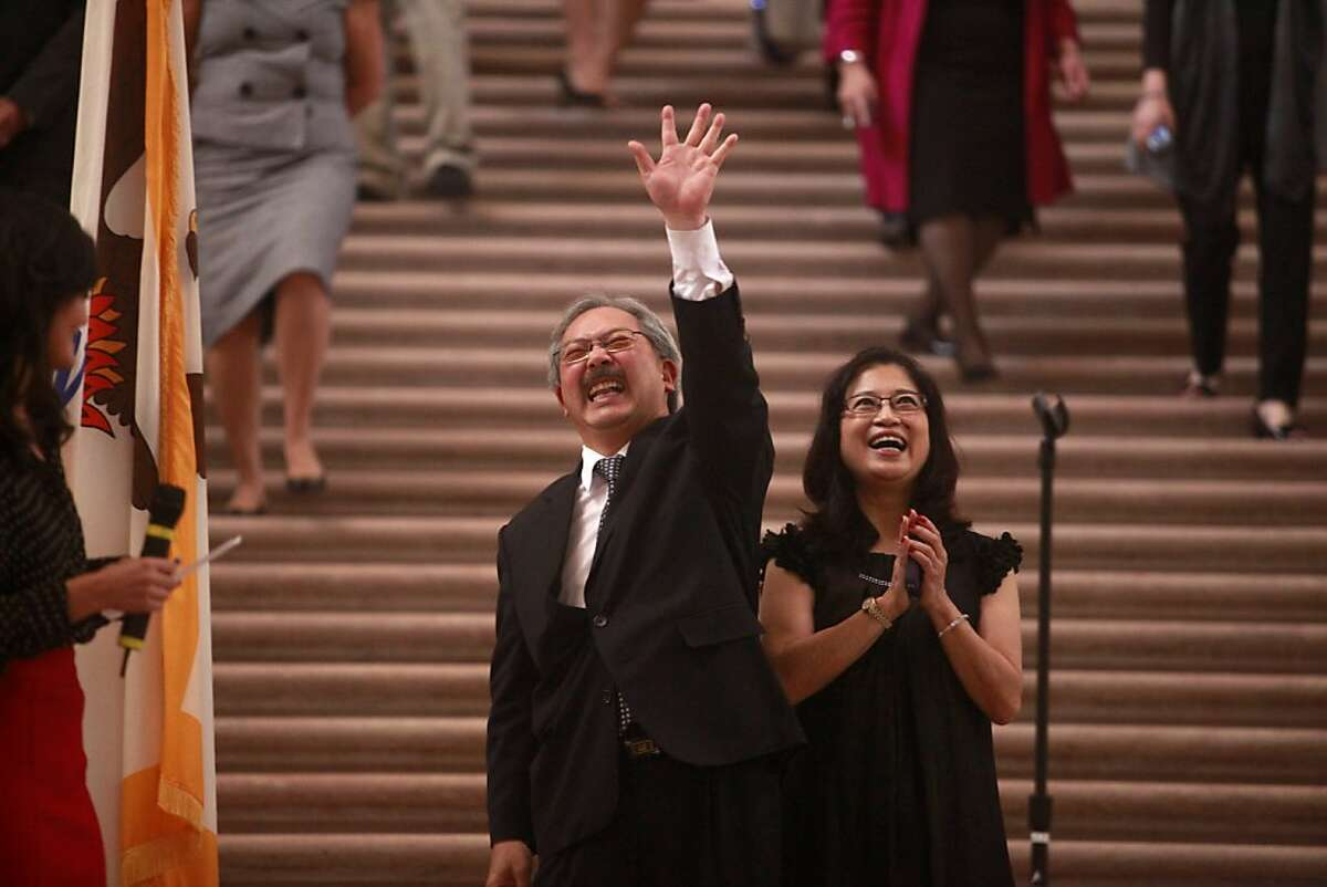 Mayor Ed Lee waves to friends in the City Hall during his birthday on Friday, May 4, 2012. Mayor Ed Lee turned 60 years old today. A surprise birthday part was held at City Hall in celebration.