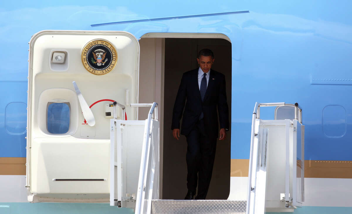 U.S. President Barack Obama exits Air Force One at Boeing Field during a visit to Seattle on Thursday, May 10, 2012 . The president was scheduled to attend two fund raisers during the visit.