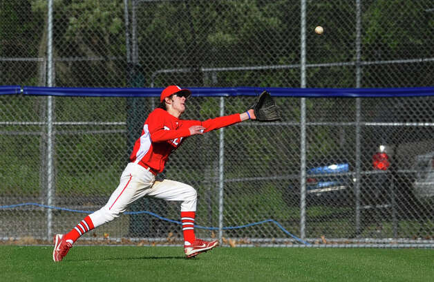Fairfield Prep's Will Brophy chases down a fly ball hit by West Haven's Bobby Moretti, during baseball action in West Haven, Conn. on Thursday May 10, 2012. Photo: Christian Abraham