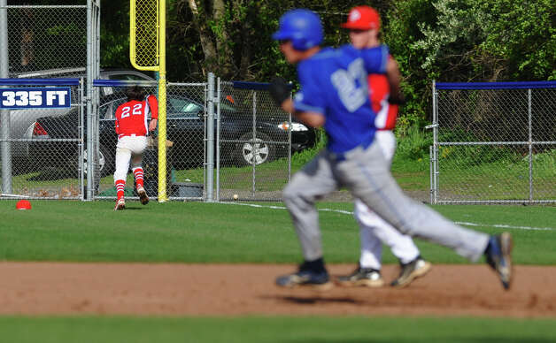 West Haven's Bobby Moretti heads to second as Fairfield Prep's Will Brophy chases down his fly ball during baseball action in West Haven, Conn. on Thursday May 10, 2012. Photo: Christian Abraham