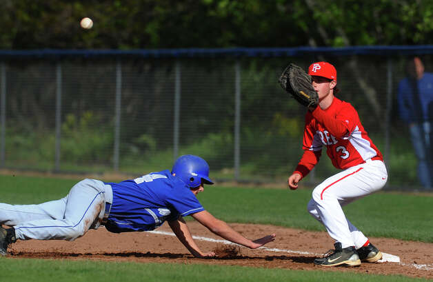 Fairfield Prep's Chris Collins attempts to pick off  West Haven's Cameron Stone, during baseball action in West Haven, Conn. on Thursday May 10, 2012. Photo: Christian Abraham