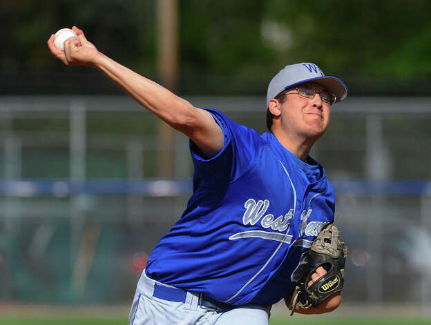 West Haven's John Carrano releases a pitch, during baseball action against Fairfield Prep in West Haven, Conn. on Thursday May 10, 2012. Photo: Christian Abraham
