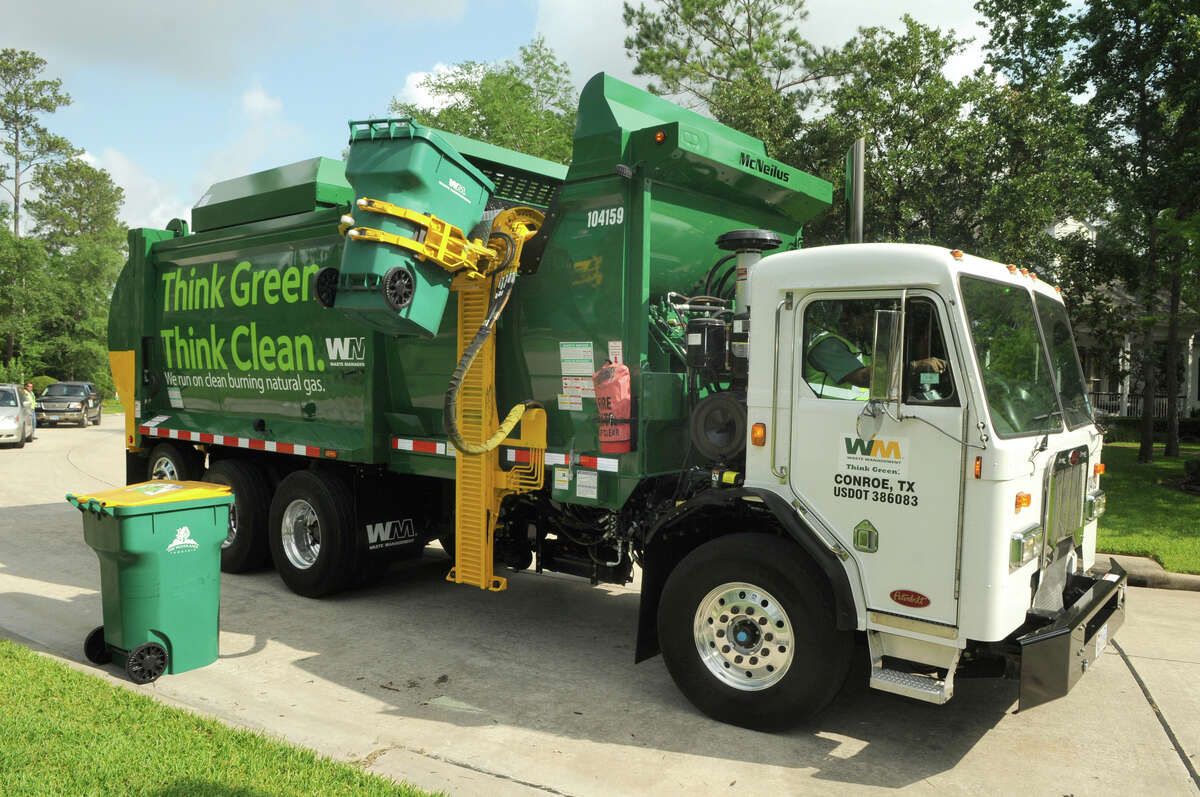 A garbage truck running on compressed natural gas makes its way along its route in The Woodlands. Driver Servando Rosales says a resident who listened for a deep diesel sound had to chase after him when she realized a quieter machine was on the route.