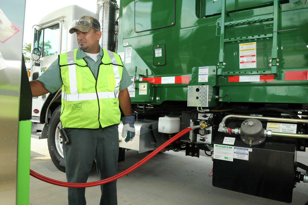 Servando Rosales, a 14-year veteran of Waste Management, refuels his garbage truck at a fast-fill compressed natural gas station that will be available to the public for refueling of consumer vehicles.