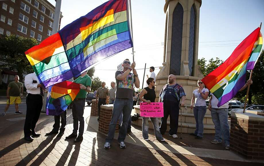Dale Robinson waves his flag for people driving by a rally of the Dallas LGBT Community to applaud President Obama's stance on Gay marriage and in the Oaklawn neighborhood in Dallas, Texas Wednesday, May 9, 2012.  (AP Photo/The Dallas Morning News, Brad Loper)  MANDATORY CREDIT; MAGS OUT; TV OUT; INTERNET OUT; AP MEMBERS ONLY Photo: Brad Loper, Associated Press