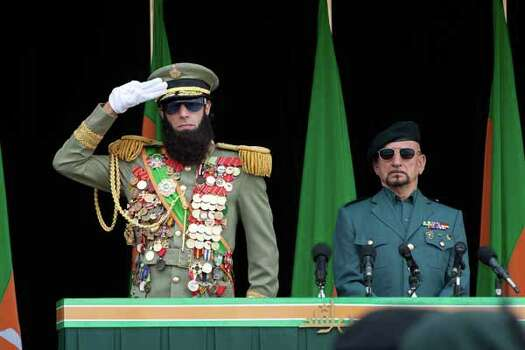 """In this film image released by Paramount Pictures, Sacha Baron Cohen, portrays Admiral General Aladeen, left, and Ben Kingsley portrays Tamir in a scene from """"The Dictator."""" Photo: Melinda Sue Gordon, . / © 2012 Paramount Pictures.  All Rights Reserved."""