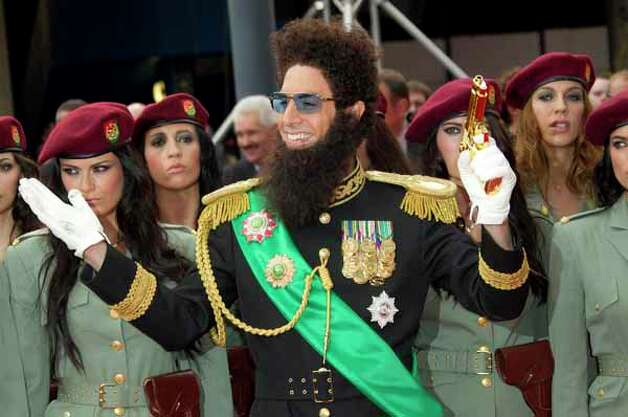 British actor Sacha Baron Cohen, who plays Admiral General Aladeen, arrives for the World Premiere of 'The Dictator', at a cinema in Soutbank in central London, Thursday, May 10, 2012. Photo: Joel Ryan, . / AP