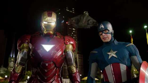 "In this film image released by Disney, Iron Man, portrayed by Robert Downey Jr., left, and Captain America, portrayed by Chris Evans, are shown in a scene from ""The Avengers"" Photo: . / Disney"
