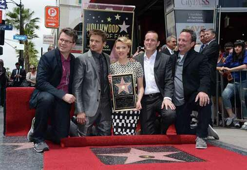 HOLLYWOOD, CA - MAY 02: (L-R) Executive Producer Jeremy Latcham, actors Jeremy Renner and Clark Gregg pose with actress Scarlett Johansson of 'Marvel's The Avengers' (C) as she is honored on the Hollywood Walk of Fame on May 2, 2012 in Hollywood, California. Photo: Jason Merritt, . / 2012 Getty Images