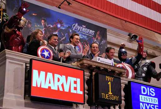 """NEW YORK, NY - MAY 01:  Actors Tom Hiddleston(fourth from left) and Clark Gregg(fourth from right) ring the opening bell at The New York Stock Exchange as part of a celebration of the release of Marvel Studios """"Marvel's The Avengers"""" on May 1, 2012 in New York City. Photo: Stephen Lovekin, . / 2012 Getty Images"""