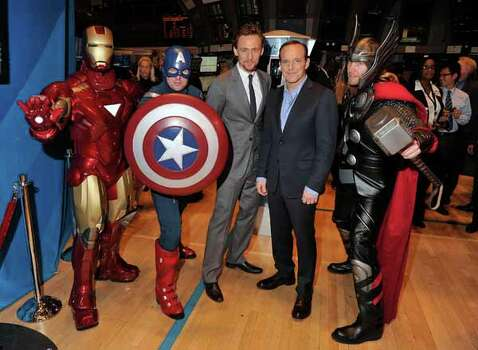 """NEW YORK, NY - MAY 01:  Actors Tom Hiddleston(third from left) and Clark Gregg(second from right) pose for a photo as part of a celebration of the release of Marvel Studios' """"Marvel's The Avengers"""" after ringing the opening bell at the New York Stock Exchange on May 1, 2012 in New York City. Photo: Stephen Lovekin, . / 2012 Getty Images"""
