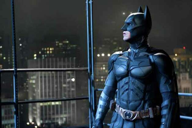 "In this film image released by Warner Bros., Christian Bale portrays Bruce Wayne and Batman in a scene from ""The Dark Knight Rises."" Photo: Ron Phillips, . / (c) 2012 Warner Bros. Entertainment Inc. and Legendary Pictures Funding, LLC"
