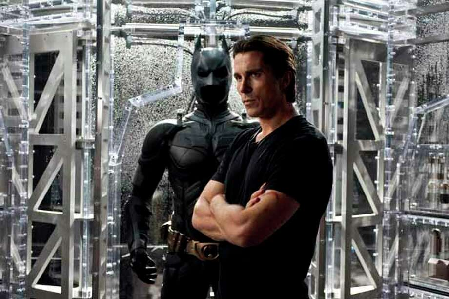 "Christian Bale returns as Bruce Wayne and Batman in  ""The Dark Knight Rises."" Photo: Ron Phillips, . / (c) 2012 Warner Bros. Entertainment Inc. and Legendary Pictures Funding LLC"