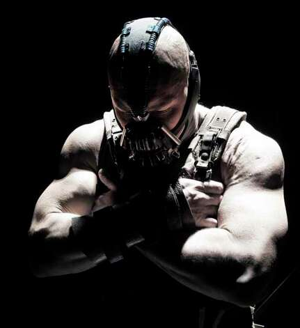 TOM HARDY as Bane in Warner Bros. Pictures��� and Legendary Pictures��� action thriller ���THE DARK KNIGHT RISES,��� a Warner Bros. Pictures release. Photo: Ron Phillips, . / © 2012 Warner Bros. Entertainment Inc. and Legendary Pictures Funding, LLC