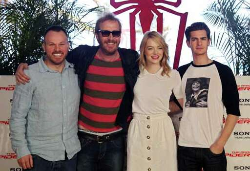 """British actors, Andrew Garfield, right, Rhys Ifans, second left, U.S. actress Emma Stone, second right, and director Marc Webb, left, pose for photos to promote their upcoming film, """"The Amazing Spider-Man"""" at the Summer of Sony 4 Spring Edition photo call in Cancun, Mexico, Monday April 16, 2012. Photo: Alexandre Meneghini, . / AP"""