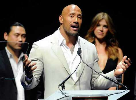 """LAS VEGAS, NV - APRIL 23:  (L-R) Director Jon M. Chu, actor Dwayne Johnson, recipient of the Action Star of the Decade Award, and actress Adrianne Palicki promote their upcoming movie, """"G.I. Joe: Retaliation"""" at a Paramount Pictures and DreamWorks Animation event at The Colosseum at Caesars Palace during the opening night of CinemaCon, the official convention of the National Association of Theatre Owners, April 23, 2012 in Las Vegas, Nevada. Photo: Ethan Miller, . / 2012 Getty Images"""