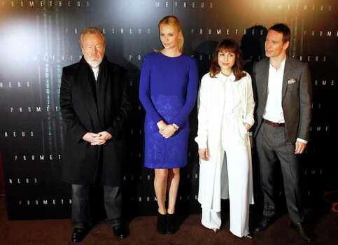 Director Ridley Scott, actors Charlize Theron, Noomi Rapace and Michael Fassbender pose prior to the screening of the trailer of Prometheus in Paris, Wednesday, April 11, 2012. Photo: Francois Mori, . / AP