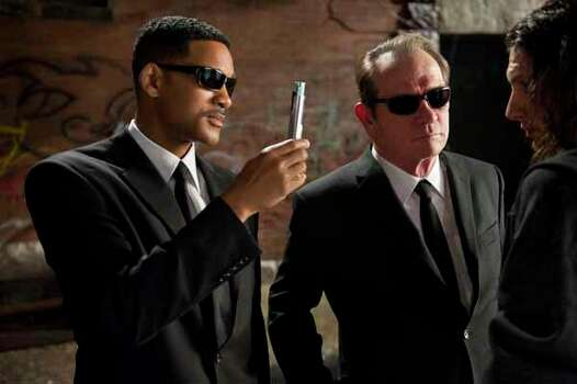 """In this film image released by Sony, Will Smith, left, and Tommy Lee Jones are shown in a scene from """"Men in Black 3."""" Photo: Wilson Webb, . / © 2011 Columbia Pictures Industries, Inc.  All rights reserved."""