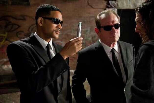 "In this film image released by Sony, Will Smith, left, and Tommy Lee Jones are shown in a scene from ""Men in Black 3."" Photo: Wilson Webb, . / © 2011 Columbia Pictures Industries, Inc.  All rights reserved."