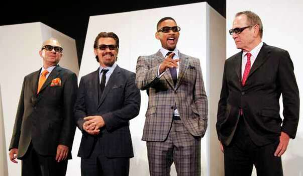 """Director Barry Sonnenfeld, left, and cast members, from second left,  Josh Brolin, Will Smith and Tommy Lee Jones pose during the Japan premiere of their film """"Men in Black III """" in Tokyo, Tuesday, May 8, 2012. Photo: Koji Sasahara, . / AP"""