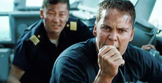 """In this film publicity image released by Universal Pictures, Tadanobu Asano, left, and Taylor Kitsch are shown in a scene from """"Battleship. Photo: . / Copyright: © 2012 Universal Studios. ALL RIGHTS RESERVED."""