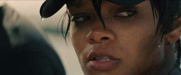 """In this film publicity image released by Universal Pictures, Rihanna is shown in a scene from """"Battleship."""" �Battleship,� a Universal Pictures movie based on the Hasbro Inc. board game, has survived an armada of tomato-throwing critics and chugged to $170 million in ticket sales overseas. The haul goes part way to justifying the reported $209-million price tag, but after subtracting splits with theater owners, it is estimated to need about half a billion at box offices to turn a profit. With a fleet of other hotly expected blockbusters surrounding its U.S. release on May 18, the tides need to be solidly in its favor to stay above water. Photo: Photo Credit: ILM/Universal Pict, . / Copyright: © 2012 Universal Studios. ALL RIGHTS RESERVED."""