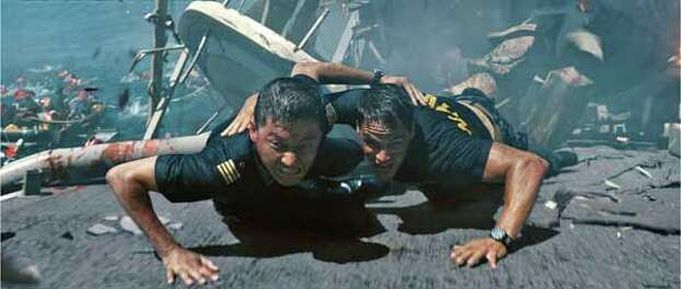 """In this film publicity image released by Universal Pictures, Tadanobu Asano, left, and Taylor Kitsch are shown in a scene from """"Battleship."""" �Battleship,� a Universal Pictures movie based on the Hasbro Inc. board game, has survived an armada of tomato-throwing critics and chugged to $170 million in ticket sales overseas. The haul goes part way to justifying the reported $209-million price tag, but after subtracting splits with theater owners, it is estimated to need about half a billion at box offices to turn a profit. With a fleet of other hotly expected blockbusters surrounding its U.S. release on May 18, the tides need to be solidly in its favor to stay above water. Photo: Photo Credit: ILM/Universal Pict, . / Copyright: © 2012 Universal Studios. ALL RIGHTS RESERVED."""