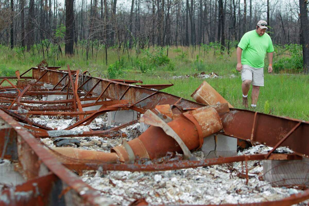 Mike Costello, a recovery volunteer for Waller County and the United Methodist Church, says he's still seeing evidence of last year's wildfires in Magnolia.