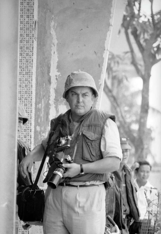In this May 1968 file photo, Horst Faas, then Associated Press Saigon bureau photo chief, is pictured with his camera during the Second Offensive in Saigon, Vietnam. Photo: Eddie Adams, Associated Press / Copyright 2012 The Associated Press. All rights reserved. This material may not be published, broadcast, rewritten or redistribu