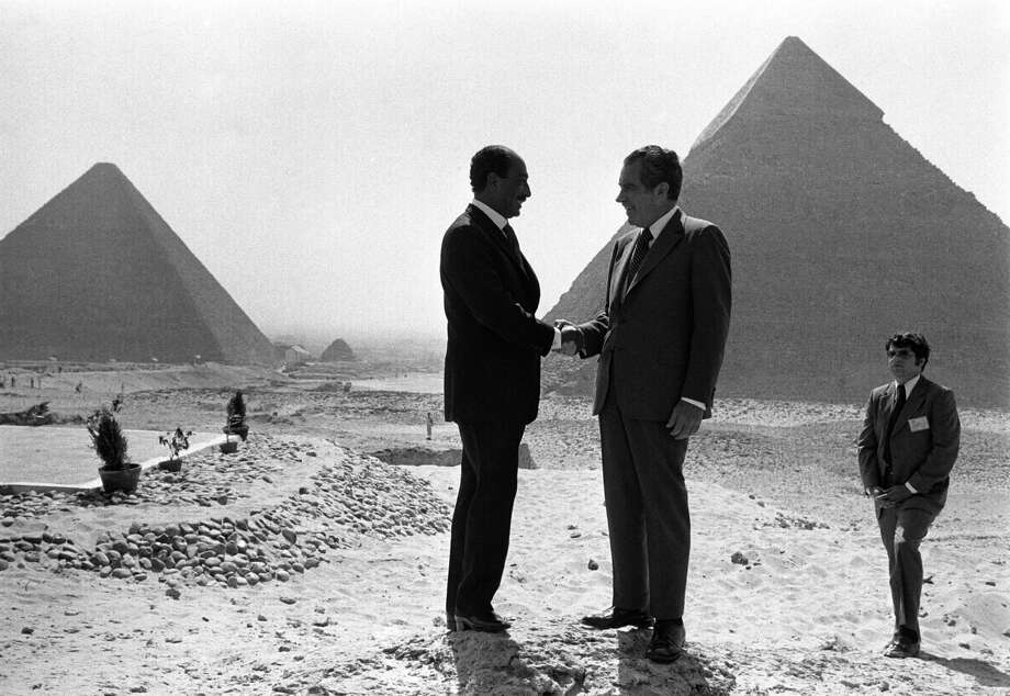 In this June 14, 1974 file photo taken by Associated Press photographer Horst Faas, Presidents Anwar Sadat and Richard Nixon shake hands for photographers as they pose in front of the pyramids at Giza, near Cairo. Photo: HORST FAAS, Associated Press / AP1974