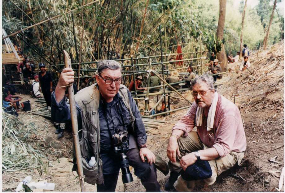 In this  March, 1998 file photo, former Associated Press Saigon photo chief Horst Faas, left, and former AP Saigon bureau chief Richard Pyle pose at a Laos crash site, as a U.S. MIA search team excavates a hillside for human remains and artifacts from a helicopter crash that killed four Vietnam war photographers in 1971. Photo: Roger King, Associated Press / AP2008