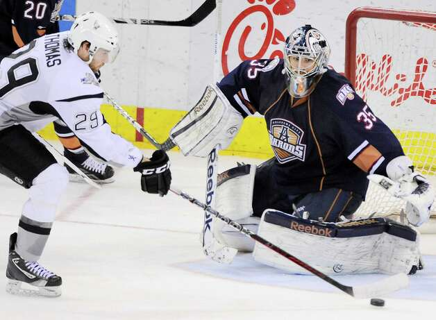 Rampage right wing Bill Thomas (left) outmaneuvers Oklahoma City Barons goaltender Yann Danis to tie the score at 1 in the third period Thursday. It was to be the Rampage's only goal. Photo: Darren Abate, Darren Abate/pressphotointl.com / Darren Abate/pressphotointl.com