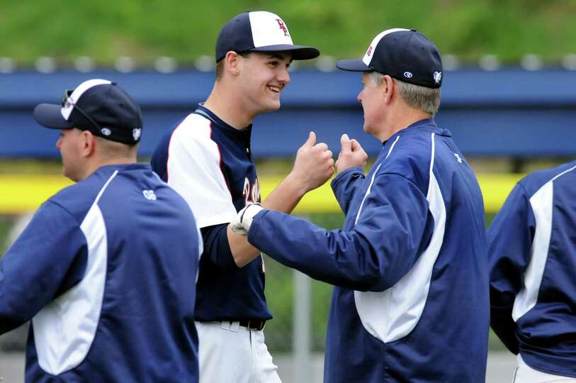 Rensselaer's pitcher Tim Burek (10), center, fist bumps coach Bob Stranahan after winning 4-0 over G
