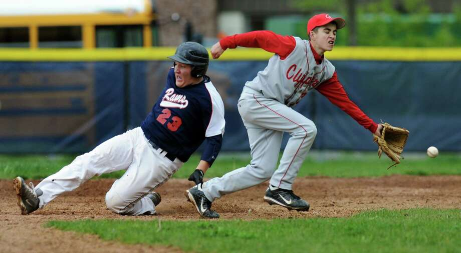 Rensselaer's Dylan Brooking (23), left, safely slides into second as Germantown's Matt Marrish (24) goes for the ball during their baseball game on Thursday, May 10, 2012, at Rensselaer High in Rensselaer, N.Y. (Cindy Schultz / Times Union) Photo: Cindy Schultz / 00017590A