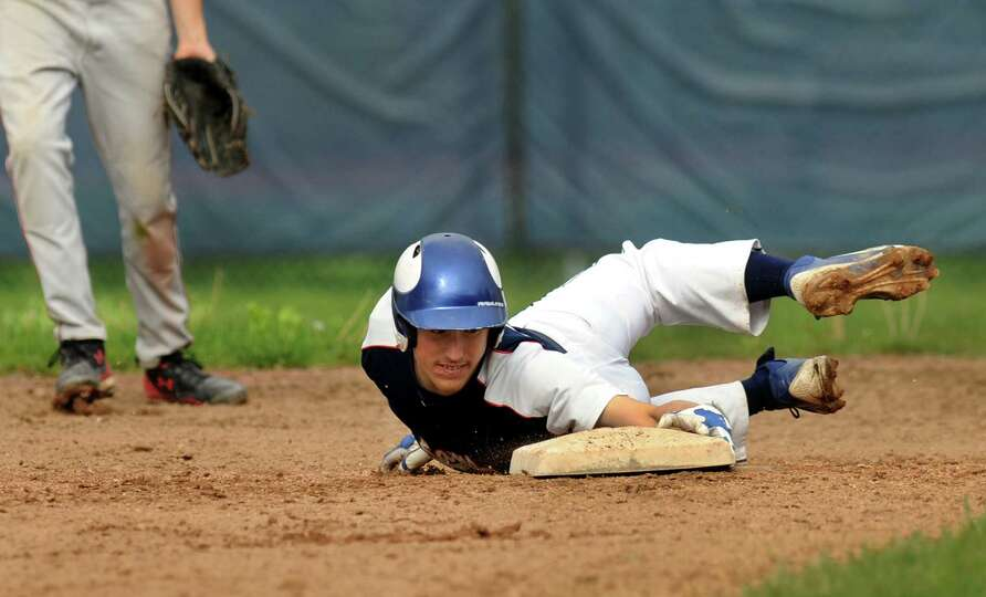 Rensselaer's Zach French (33) safely steals second during their baseball game against Germantown on