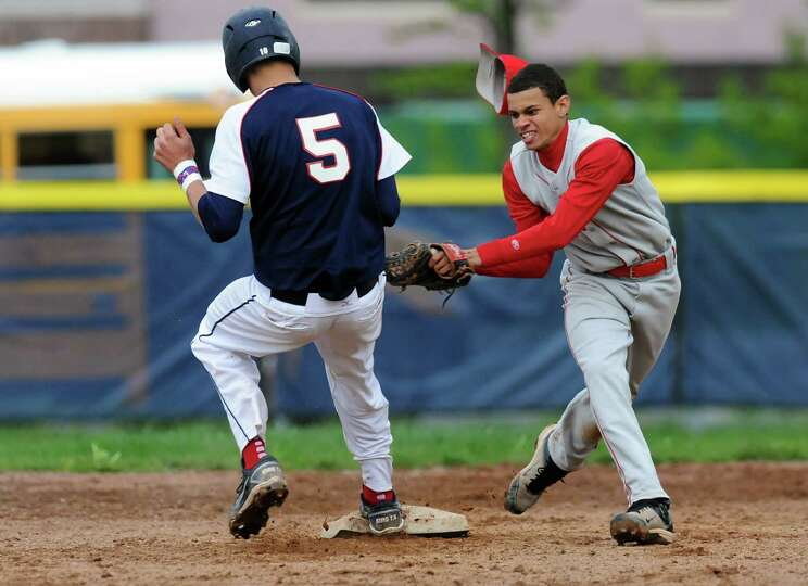 Rensselaer's Tyler Oliver (5), left, gets back to second before Germantown's Nolan Lewis can make th