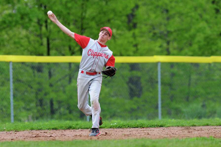 Germantown's Rob Bruggeman (2) throws the ball to make the out at first during their baseball game a